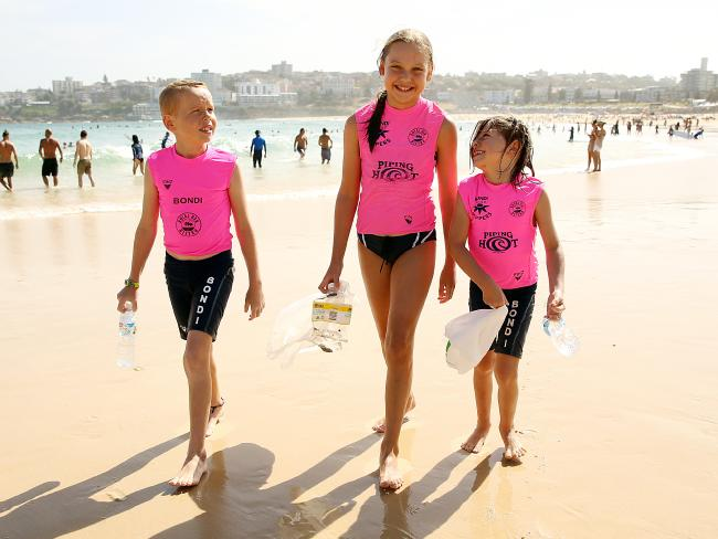 Bondi nippers Jana Kowalski (middle), Darcy Davey (left) and Neve Davey (right) want to help keep our beaches clean. Picture: Sam Ruttyn