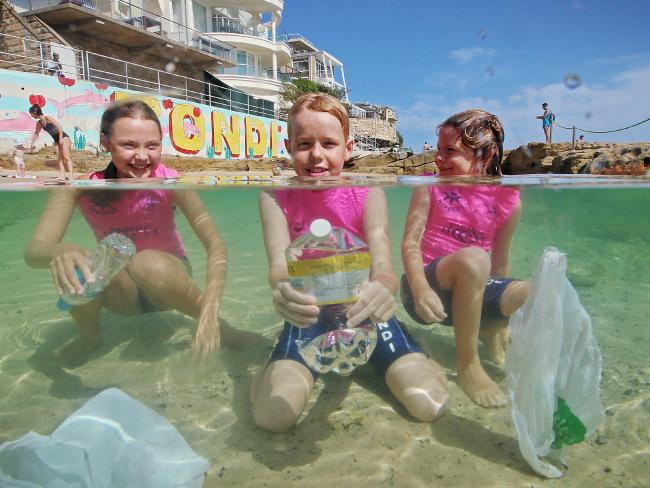 Surf Life Saving NSW and Clean Oceans Australia team up to get rid of plastics at beaches. Bondi nippers (from left) Jana Kowalski, Darcy Davey and Neve Davey, are getting involved. Picture: Sam Ruttyn